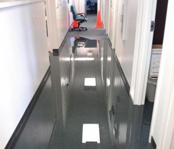 Flood water in an office hall,