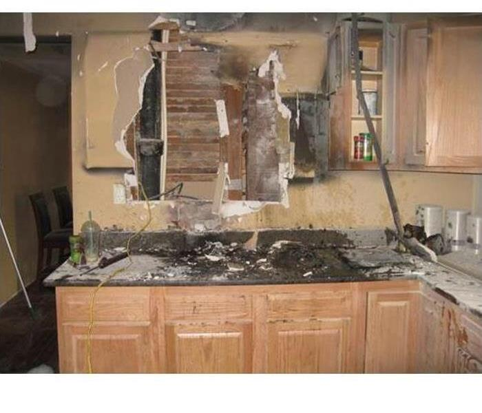 burned kitchen wall and cabinets